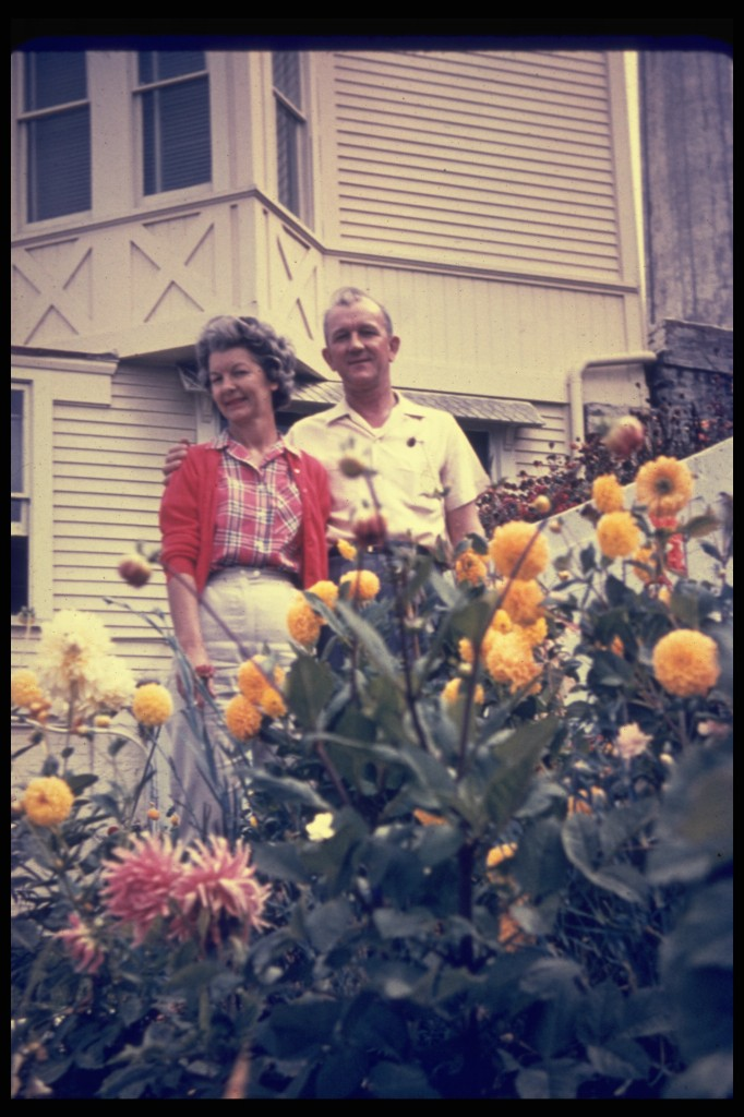 The Medical Officer and his wife, Mrs. Casey, with their dahlias outside of their Officers' Row home. Photo courtesy of J. Babyak, 1961ca